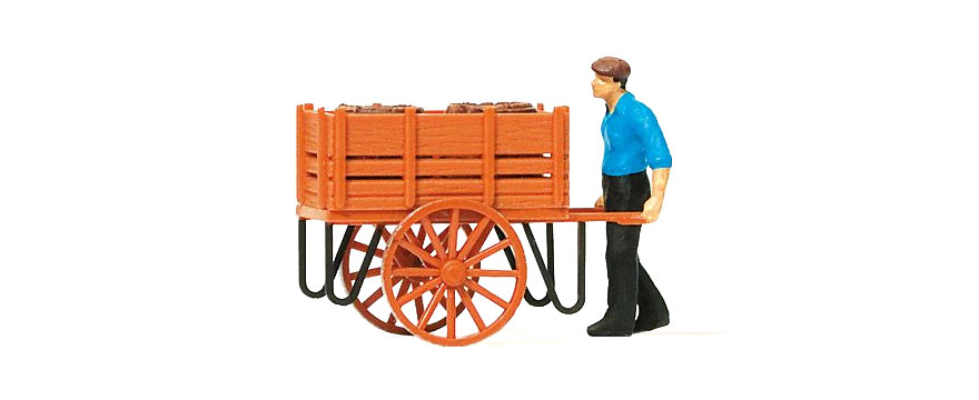28131 Worker with hand cart